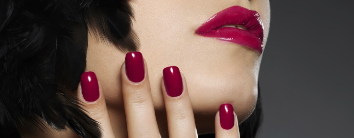 Photo of woman with fashion red nails and  lips